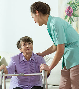Champion Home Health caregiver help client stand up in her home in Stuart, FL